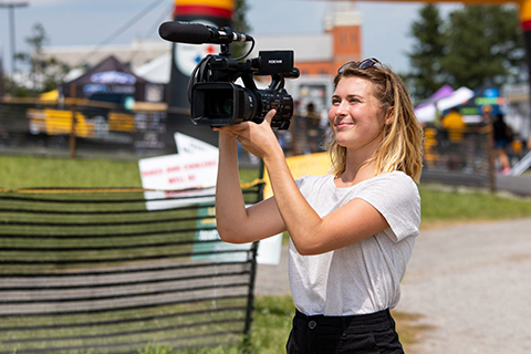 student using a camera during steelers training camp