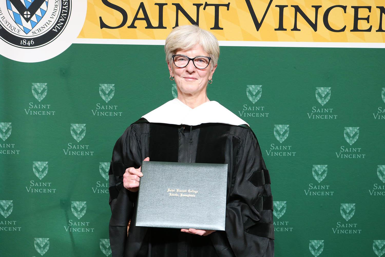 Jeri Eckhart Queenan with degree